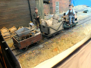 Photo: 024 A splendid pair of goods wagons and man-rider carriage wait for a loco to pick up the train and transport it to another part of the farm .