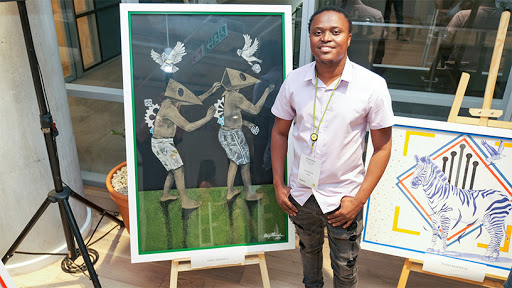 Runner-up Percy Maimela and his artwork, commissioned by ExposeIT/Huawei. (Photo: PaulMcGavin)