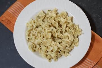 Egg noodles with herb butter sauce