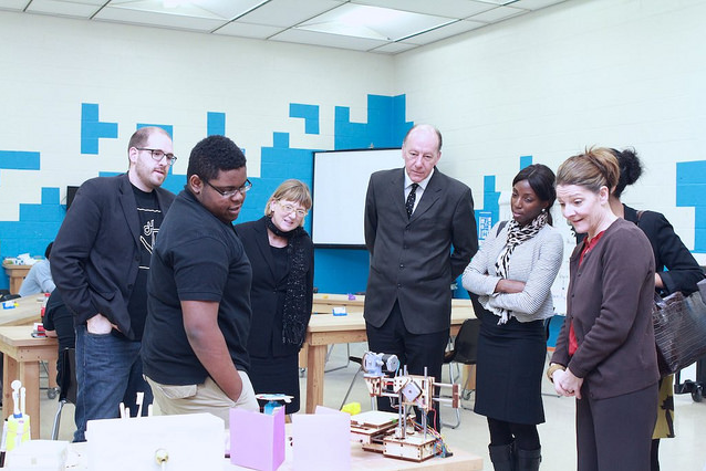 Darius McCoy (left) shows off his 3D printer to U.S. Department of Education officials. (Photo courtesy of Digital Harbor Foundation)
