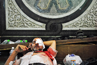 Photo: Injured protesters inside Al Fat'h Mosque after deadly clashes break out during Friday's 'Day of Rage' protest. At least 95 people are reported killed in the clashes. Cairo, EGYPT - 16/8/2013. Credit: Ali Mustafa/SIPA Press