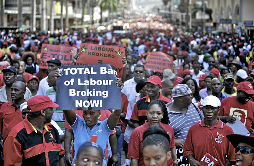 Protracted battle: Thousands of Cosatu and other union members march in Durban against labour brokers and e-tolls in this file picture. A landmark judgment has ruled that employers who use labour brokers are obliged to permanently employ qualifying temporary staff after three months. Picture: THE TIMES