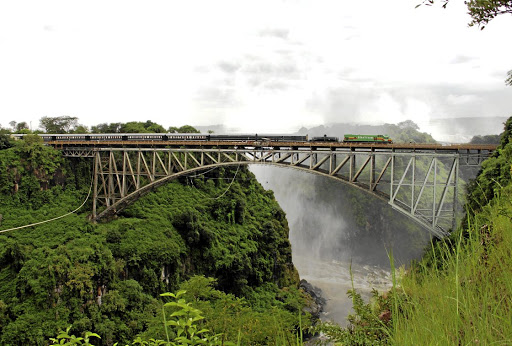 A Sheltam diesel on hire to Rovos Rail hauls the luxury Pride of Africa train across the Victoria Falls bridge. Picture: Sheltam