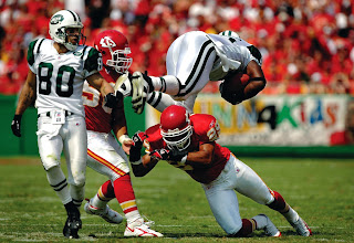 Photo: DENVER - SEPTEMBER 11:  Tight end Chris Baker #86 of the New York Jets gets flipped over safety Sammy Knight #29 of the Kansas City Chiefs in the second quarter on September 11, 2005 at Arrowhead Stadium in Kansas City, Missouri.    (Photo by Brian Bahr/Getty Images) *** Local Caption *** Chris Baker; Sammy Knight