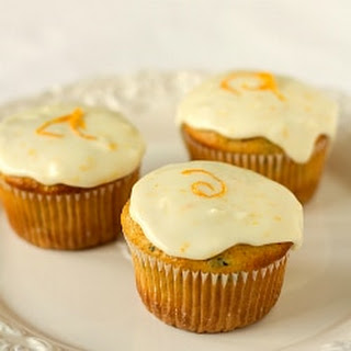 Zucchini-Pineapple Cupcakes with Orange Sour Cream Frosting.