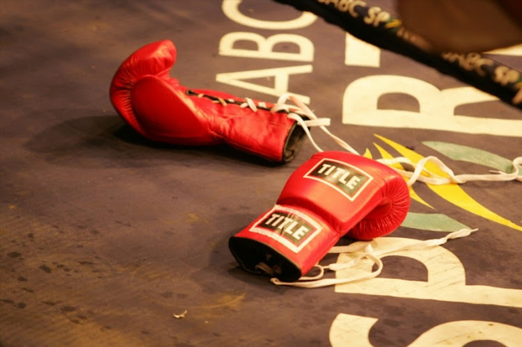 Gloves lays on the ring floor during the Lightweight bout between Patrick Malinga and Maxwell Phofana at Nasrec in Johannesburg.