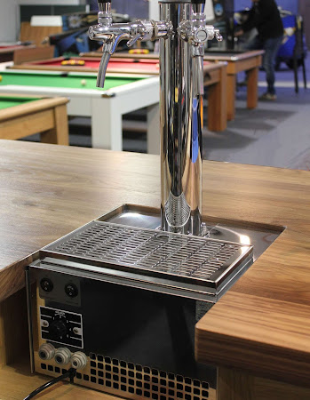 a beer tap that has been installed on the prestige bar