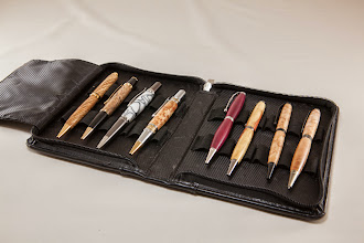 "Photo: Gary Guenther 1/2"" x 5-1/4"" pens [left to right: zebrawood, spalted maple, acrylic, maple burl, purpleheart, box elder, birds eye maple, curly maple]"