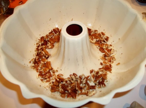 Preheat oven to 350 degrees F. Grease the inside of the Bundt pan. Sprinkle...