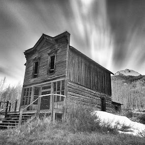 Bird House by George Kremer - Buildings & Architecture Decaying & Abandoned ( sky, brush, mountains, atmosphere conditions, ghost town, monochrome, weather, aged, boards, black and white, clouds, abandoned )