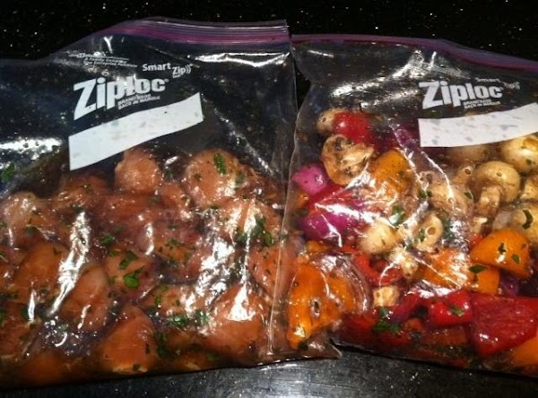 PUT CHUNKS OF CHICKEN INTO A PLASTIC GALLON BAG N PUT VEGGIES IN ANOTHER...