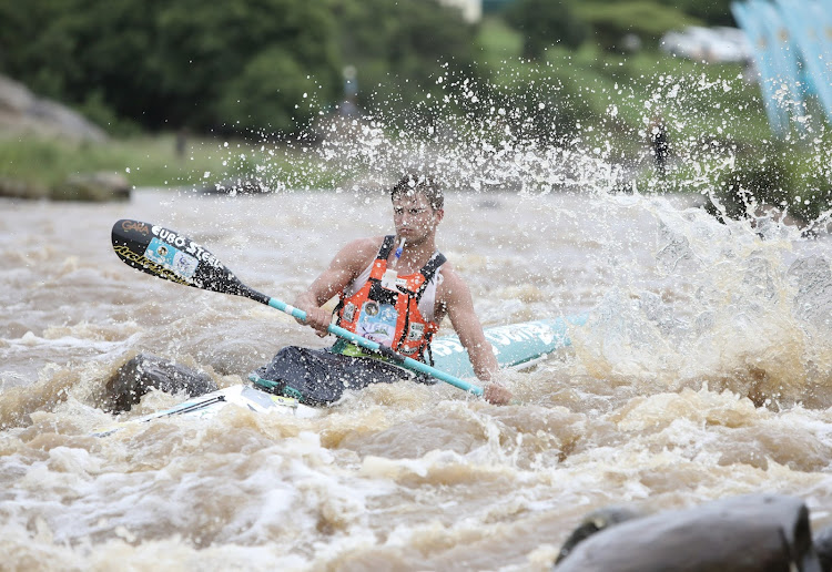 Alan Houston paddling through Mission Rapids at the start of Day 1 of the Dusi Canoe Marathon.