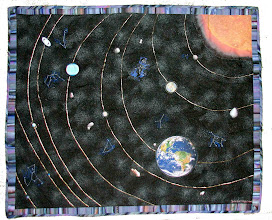 "Photo: Sabbath: Heavenly View ""And the Heavens and the Earth were completed, and all that they contain""  The planets and asteroids are all actual photographs.  The Sun is from the STEREO project.  The constellations are machine-embroidered. I made a point of including the AnneFrank asteroid, thanks to Ted Stryk for that photo, it seemed appropriate for a Jewish quilt.  The beauty and delicate color of the space photographs does not come across in this photo.  Needless to say, this is not even close to scale.  And yes, I included Pluto, it may not be a planet but it's still a part of the solar system.  The picture of Mercury is from the latest MESSENGER fly-by on 1/21/2008 and was actually added to the quilt on top of the previously available photo as the quilt was in already progress on that date. For info on the ongoing Messenger and STEREO missions, see the www.JHUAPL.edu, I apologize there is not room for all the photo credits here, most are from NASA and Hubble."