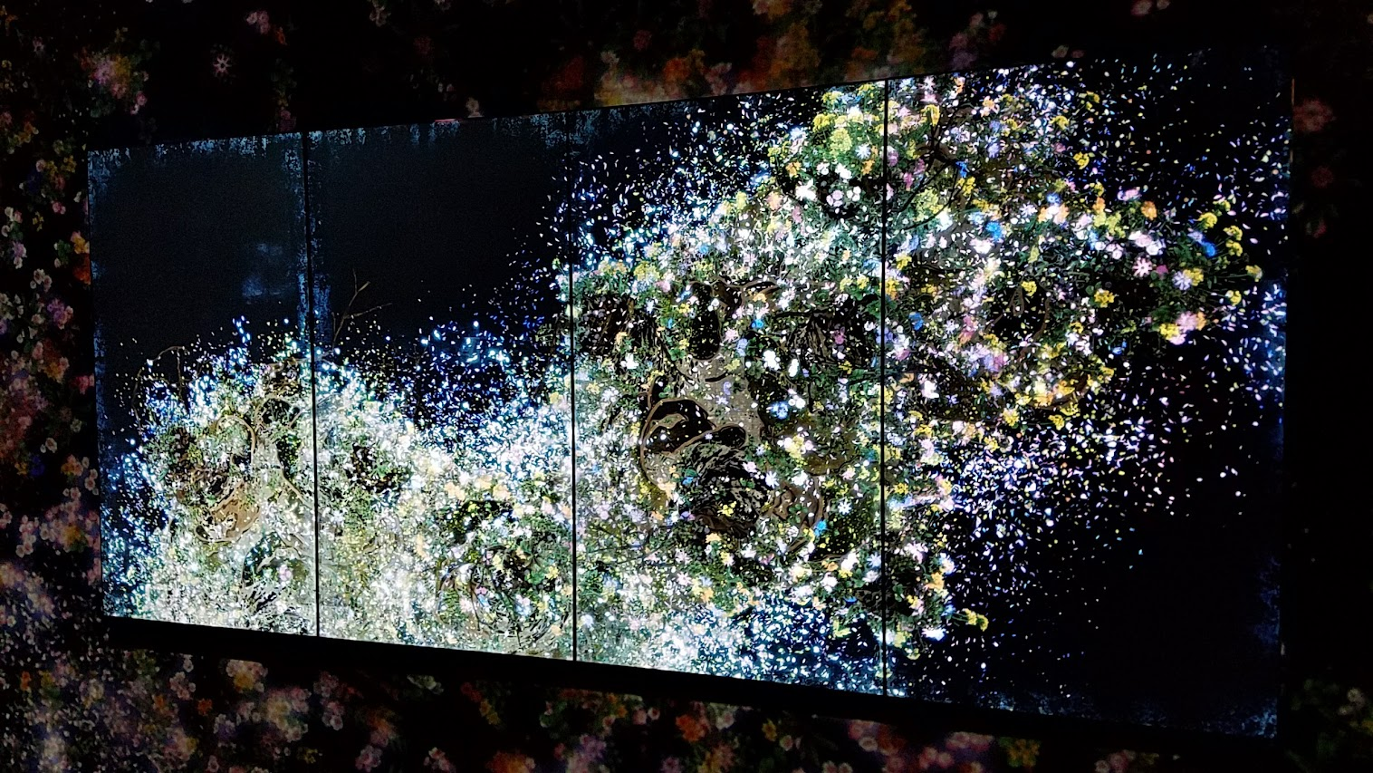 Ever Blossoming Life II - A Whole Year per Hour, Dark as part of Pace Art + Technology exhibit Living Digital Spaces and Future Parks. This is the TV screen inside the next room - it switches between Butterfly and Ever Blossoming. This artwork is in continuous change, over a period of one hour a seasonal year of flowers blossoms and scatters. Flowers are born, grow and blossom in profusion before the petals scatter, and the flowers wither and fade away. The cycle of birth and death repeats itself, continuing for eternity. The entire work changes continuously. The same state will never be repeated.
