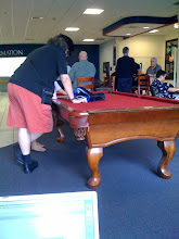 Photo: Mathematicians using a billiards table as a desk for mathematics research.