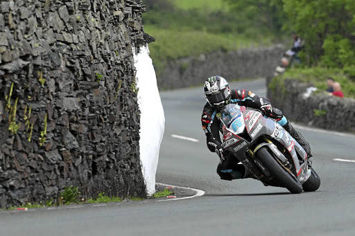 Michael Dunlop weaves between old stone walls on the way to another win in the first Supersport TT race. Picture: IOMTT