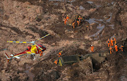Rescue crew work in a tailings dam owned by Brazilian miner Vale SA that burst, in Brumadinho, Brazil January 25, 2019.
