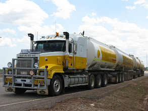 Photo: Northern Territory AB-Quad tanker road train. Trailer arrangement is B-double towing two tri-axle trailers
