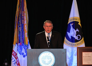 Photo: Bob Ulin, CGSC Foundation CEO, asks the attendees to stand for the presentation of the colors