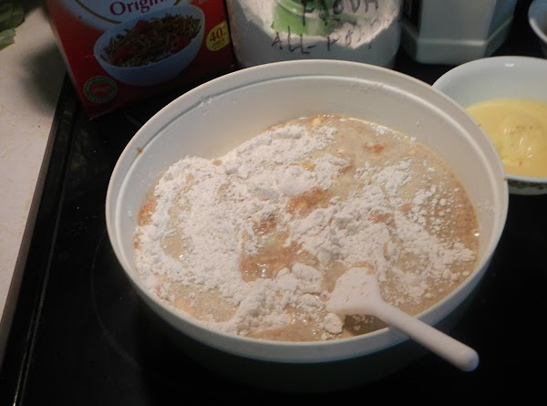 Add the sifted dry ingredients into the liquid mixture. Beat the egg whites till stiff.