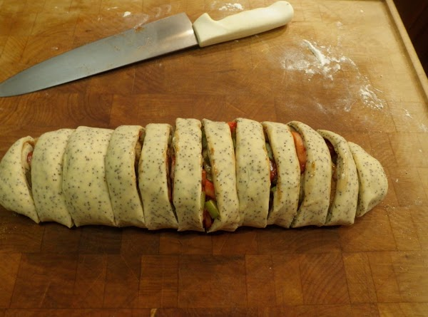 Roll up in jelly roll fashion pinching the edges and ends together (Roll will...