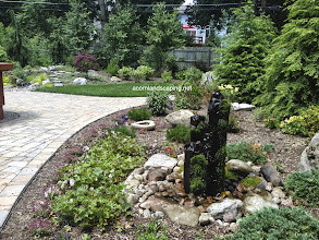 Photo: Garden Fountains, #FountainContractor Monroe County, Rochester NY. Acorn Ponds & Waterfalls, Certified Aquascape Contractor since 2004.  Visit our website www.acornponds.com and please give us a call 585.442.6373.  Check out these easy to take care of #Fountains installed by Acorn Ponds & Waterfalls in Rochester NY. They look even better in the winter with changing ice formations every day and need very little maintenance.  To learn more about Fountains, please click here: www.acornponds.com/fountainscapes.html  Click here for a free Magazine all about Ponds and Water Features: http://flip.it/gsrNN  Click here for more information on fountains: www.facebook.com/notes/acorn-landscaping-landscape-designlightingbackyard-water-gardens/garden-fountains-fountain-design-fountain-installer-bubbling-urns-boulders-water/468911673145960  Find us on Houzz here: www.houzz.com/pro/acornlandscapedesign/acorn-landscaping-and-ponds-llc  Acorn Ponds & Waterfalls   585.442.6373 www.acornponds.com