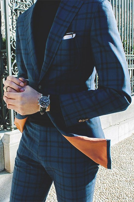 Man in checkered suit.