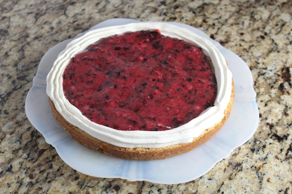Place 1st half layer on cake plate. Fill a pastry bag with whipped cream,...