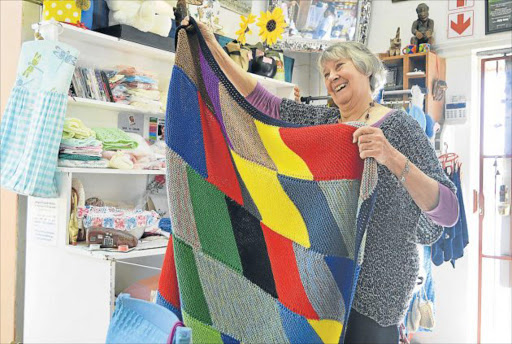 HELPING OTHERS: Toni Krull, of Hands On, holds one of the blankets made by her knitting club Picture: INGANATHI WILLIAMS