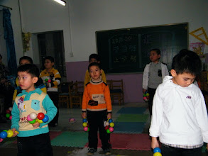 Photo: baby son, warrenzh, 朱楚甲, performing among his classmates in year end party in QRRS 1st kindergarten.