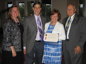 Photo: District Governor Cynde Covington, Sherwood Weisman, Susan Weisman, and President Blaine Timmer - June 5, 2010 - Susan is holding her Paul Harris Fellow Certificate.