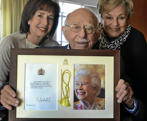 Queen elizabeth sends sa man 100th birthday wishes ton up port elizabeth man denzil levy holds the card he received from queen elizabeth bookmarktalkfo Choice Image