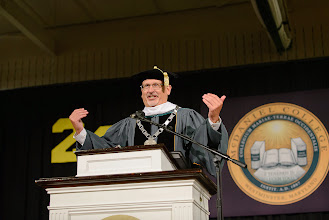"""Photo: President Casey gives his James Brown """"I Feel Good"""" rendition to open the 143rd Commencement ceremony."""