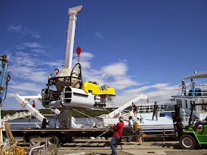 Photo: Crew members load DeepSee submersible aboard R/V Argo for Cocos Island Expedition (Photo credit: P. Auster/NSF Grant N. DRL-1114251)