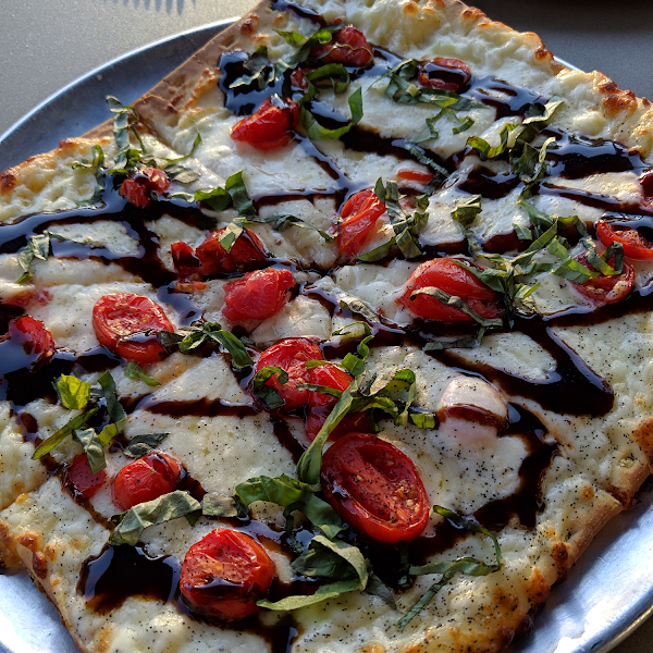 Caprese pizza with a balsamic reduction...so very good!