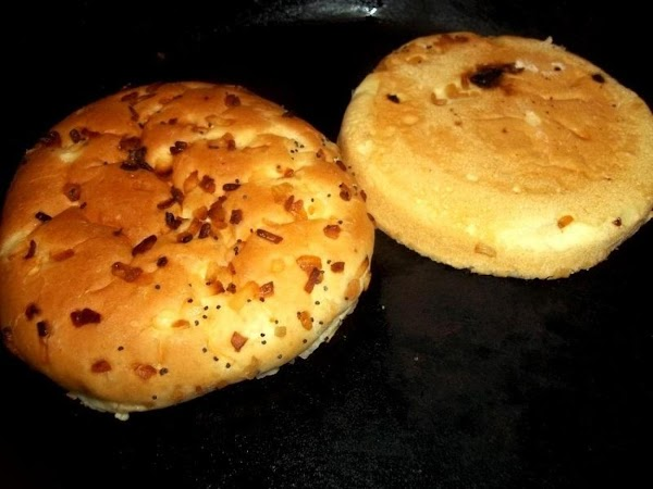 I butter both sides of bun and place then in my iron skillet to...