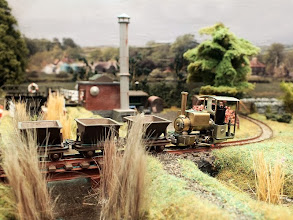 Photo: 015 Rod Allcock's scratchbuilt Kerr Stuart Wren crosses the bridge over Pig Dyke with a train of skips that Rod has very cleverly adapted using Roco chassis and shortened Parkside Dundas Rugga bodies