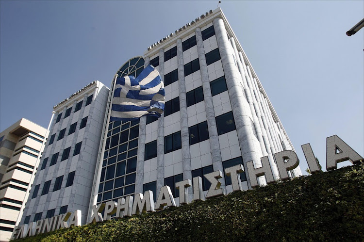 The Greek flag flies outside the Stock Exchange building in Athens, Greece. Picture: EPA/ALEXANDROS VLACHOS