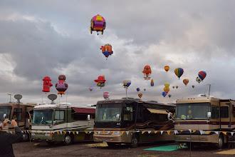 Photo: balloons over head