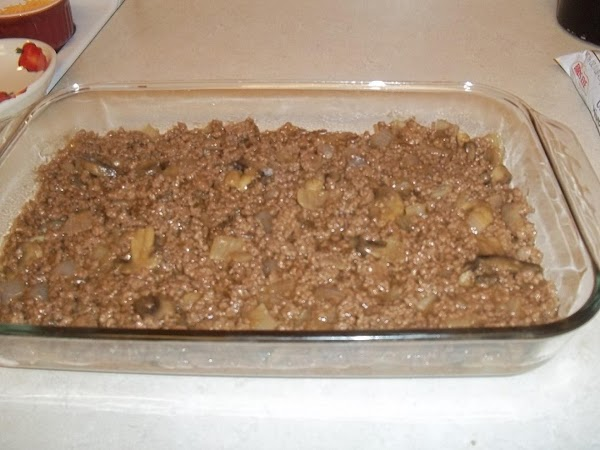 Remove from heat and spread meat mixture into the bottom of a 9x13 pan.