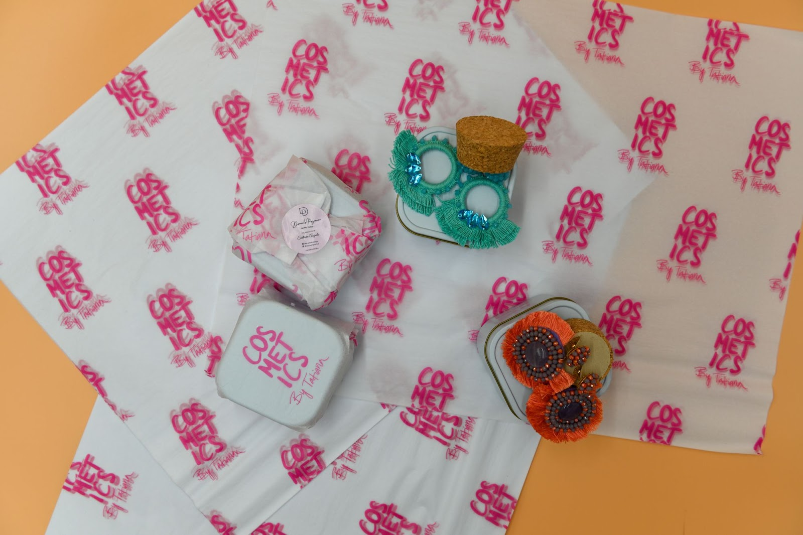 Earrings and tissue paper packaging