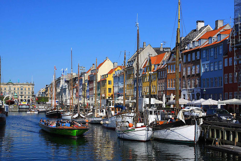 Nyhavn is the 17th century waterfront area of Copenhagen, Denmark, known for its cafes and charm.
