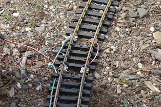 Photo: Trolley track slowing ciruitry entry point. There are 6 diodes wired in series to drop the voltage applied and slow the trolley