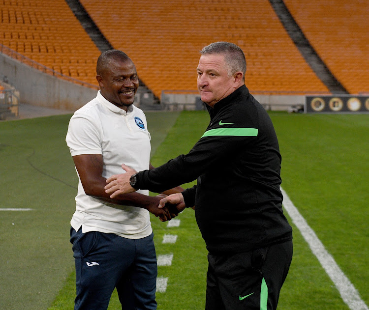 Victorious Richards Bay head coach Simo Dladla shakes hands with his Kaizer Chiefs counterpart Gavin Hunt after the KZN team beat the Soweto giants in the Nedbank Cup last-32 at FNB Stadium on February 7 2021.