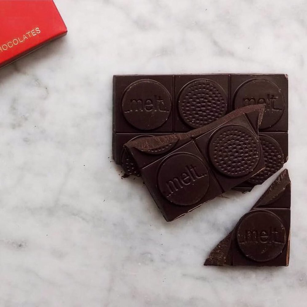 Spice and Chocolate combination; Melt's Chilli Dark Bar placed on a white marble surface