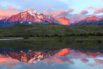 Photo: Sunrise at Torres del Paine  It took me a few days to get this shot. I had to find a small, shallow and reasonably well sheltered pool that would give me a suitable reflection, then wait for the weather to behave - something that doesn't happen too often here because it is notoriously windy!  On this particular morning the wind was calm but there was a lot of cloud behind me blocking the sun. I was very close to giving up when the sun suddenly broke through and lit up the mountains in spectacular fashion. It lasted all of 20 seconds before everything went dull again. Those 20 seconds had me smiling all day :)  #MirrorMonday by +Gemma Costaand +Elizabeth Edwards (+Mirrors and Reflections) #MountainMonday by +Michael Russell(+Mountain Monday) #NationalParksMonday by +Juan Pons(+NationalParksMonday) #NatureMonday by +Rolf Hickerand +Kate Church