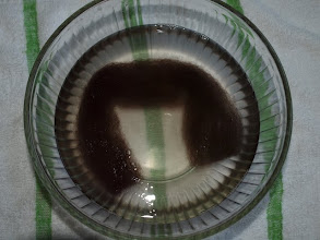 Photo: Fill a bowl with hot tap water (as hot as you can stand to touch) and stir in a couple 2-3 drops of dish washing liquid.  Add the wool and carefully push it under the water.  Let it soak, undisturbed, for about 2 minutes.  Soak only 1 dread at a time or they will get felted together into a big clump.  When your ready to make the next dread, you will need to reheat the water.  I put it in the microwave for a minute or 2.