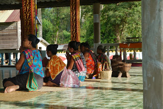 Photo: Women performing their morning prayers and food presentation to the monks at village temple