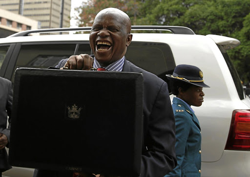 CHEERFUL   Zimbabwean Finance Minister Patrick Chinamasa arrives to present his budget to parliament in Harare, Zimbabwe, on Thursday.