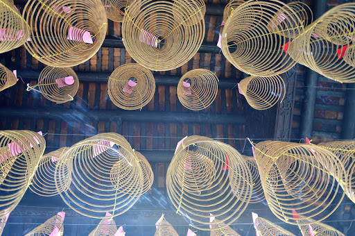 vietnam-curled-incense.jpg - Beautiful curled incense hangs from a temple in Hanoi.